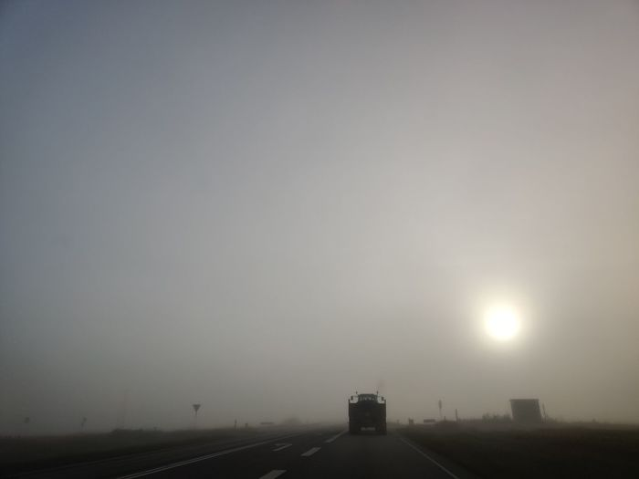 Road against sky during foggy weather