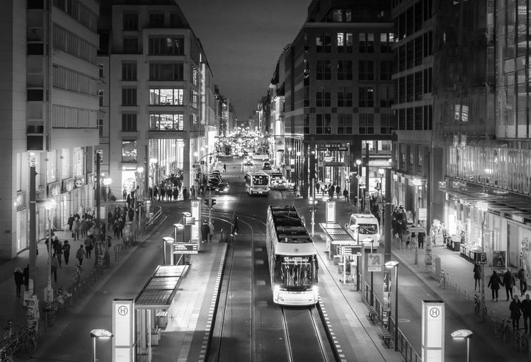 Black And White Street Photography Night Friedrichstrasse Shopping Tram Traffic Famous Place Public Transportation Tiltshift Illuminated City Transportation Architecture Building Exterior Built Structure Street Mode Of Transportation Land Vehicle Motor Vehicle Car Road City Life High Angle View Incidental People City Street Building Motion Nightlife 17.62° My Best Photo