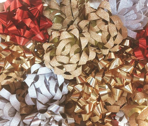 Gold and silver and red ribbon in flower style for a gift box. Puff Flower Bow Full Frame Backgrounds Large Group Of Objects Decoration Christmas Shiny