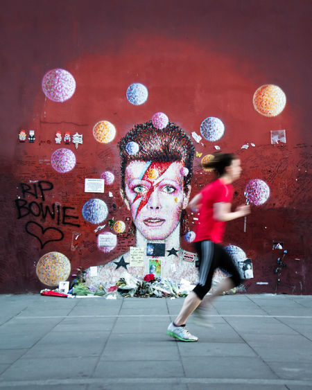 Adult Blackstar Brixton David Bowie Davidbowie EyeEm LOST IN London EyeEm Selects Full Length Graffiti Graffitiporn James Cochran Jogging Leisure Activity London Memorial Motion Murales One Person Outdoors Rock Running Space Oddity Women Young Women Ziggy