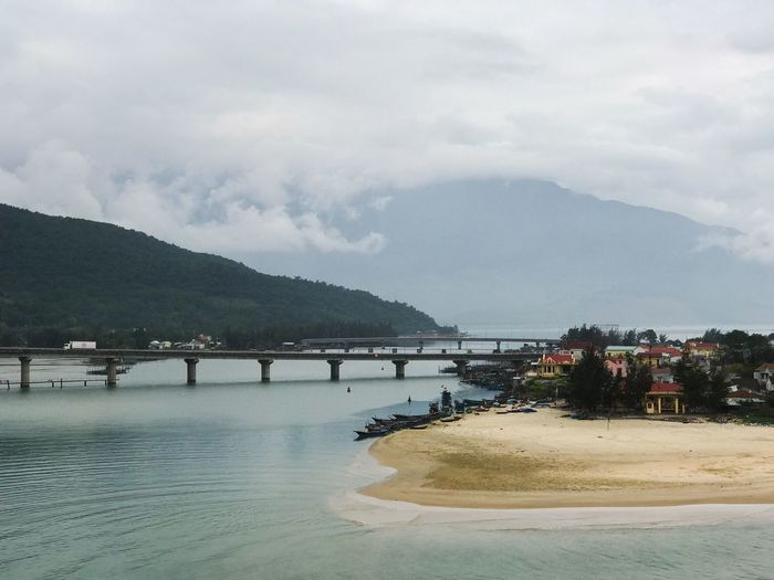 Outdoors South East Asia Tourism Travel Destinations Travel Photography Road Trip Road Viewpoint Hai Van Pass Water Beautiful View Vietnamese Island Bay Bridge View Bridge - Man Made Structure Water Beach Cloud - Sky Sea Sky Mountain Sand Nature Outdoors Beauty In Nature No People Scenics Architecture Tree