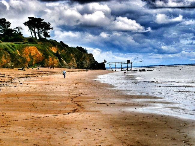 Beach Cloud - Sky Sand Sea Vacations Nature Tree Water Sky Travel Destinations Outdoors Scenics Tranquility Landscape One Person One Man Only Beauty In Nature Horizon Over Water Tranquility HuaweiP9Photography Horizon Over Water La Bernerie En Retz Loire-atlantique France🇫🇷 High Angle View Low Tide