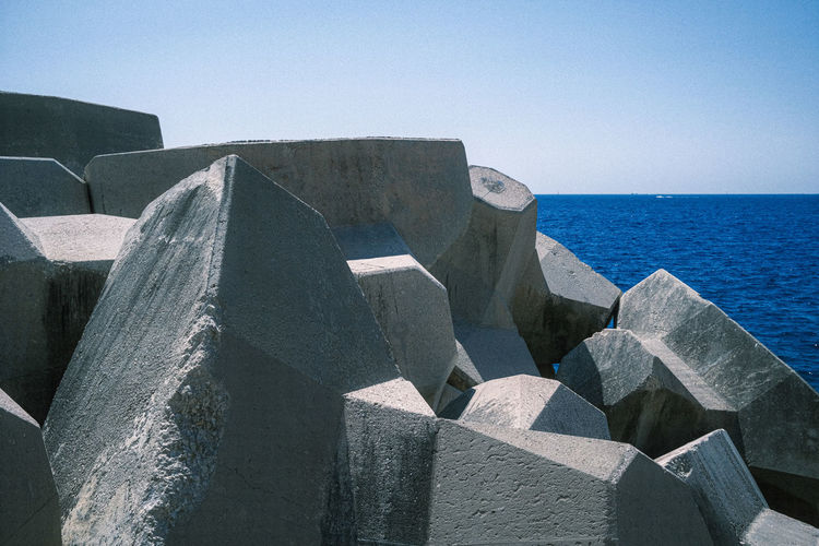 Cubic wave breaker stones on the shores of nice, france