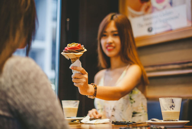 Day Dessert Food Food And Drink Freshness Friendship Ice Cream Indoors  Indulgence Ready-to-eat Real People Selective Focus Store Sweet Food Unhealthy Eating Women Young Adult Young Women