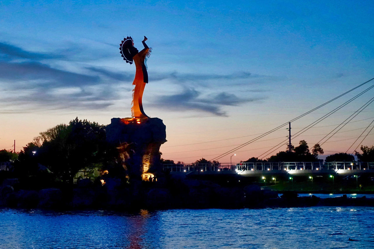 sky, water, statue, sunset, sculpture, architecture, cloud - sky, nature, representation, human representation, waterfront, built structure, no people, building exterior, art and craft, female likeness, river, travel destinations, craft, outdoors