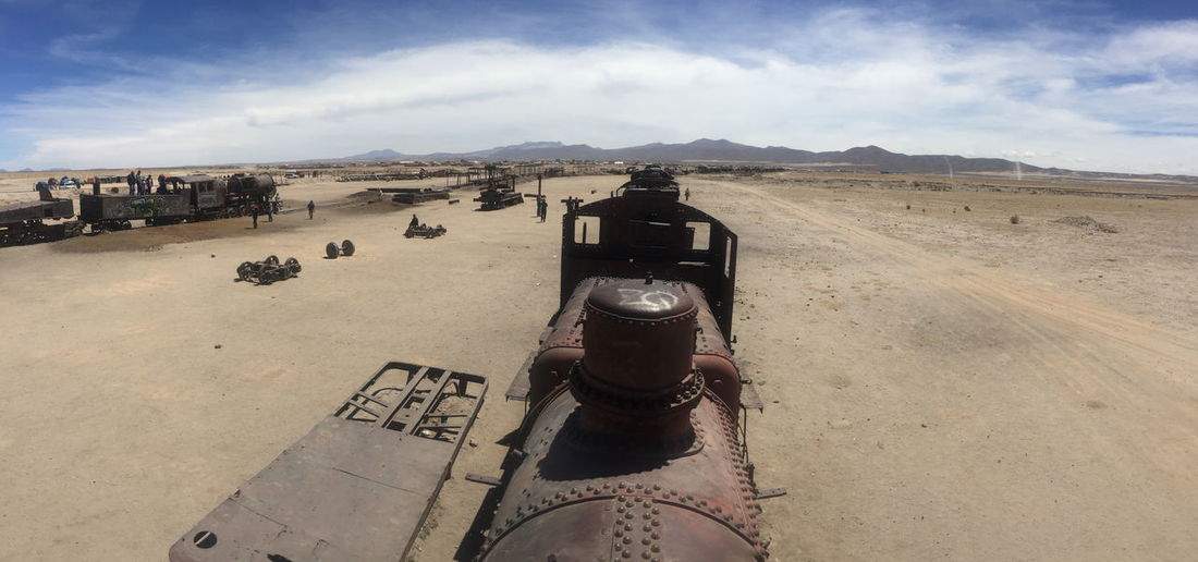 Bolivia Panorama Uyuni Uyuni Salt Flat Arid Climate Climate Cloud - Sky Conflict Day Desert Environment History Incidental People Land Landscape Military Old Outdoors Scenics - Nature Sky The Past Train Transportation Uyuni Train Cemetry Weapon