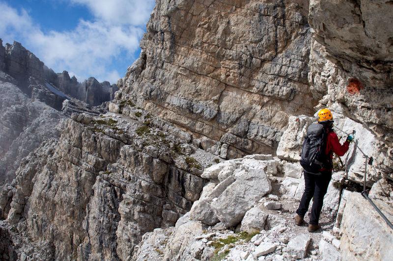 Rear view of woman mountain climbing