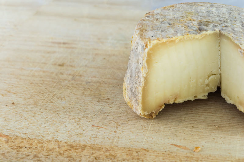 Close-Up Of Cheese On Wood