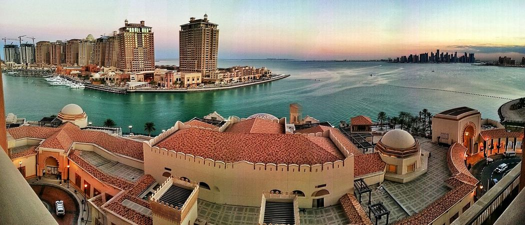The Pearl - Doha, Qatar Doha Doha,Qatar The Pearl, Doha What A View Dusk Persian Gulf Cityscapes Marina Green Water Middle East Style Architecture ManmadeVsNature Manmade Island Seaside Canon Canon Eos Rebel SL1 No People Taking Photos Arabian Sea Arabic Style Backgrounds Showcase March Miles Away