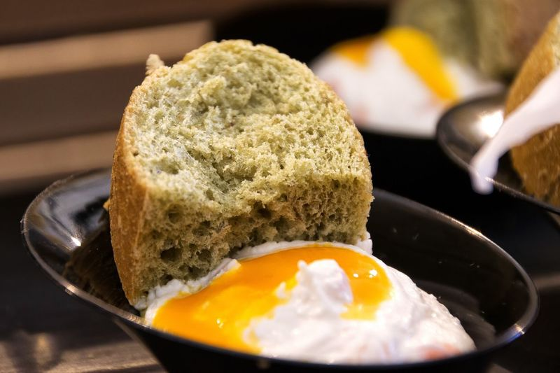 Close-Up Of Poached Egg And Bread In Bowl