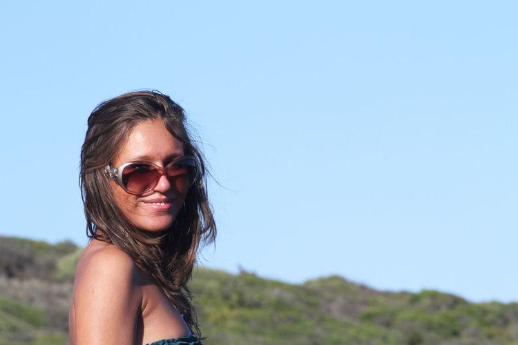 Portrait Of Woman Wearing Sunglasses Against Clear Blue Sky