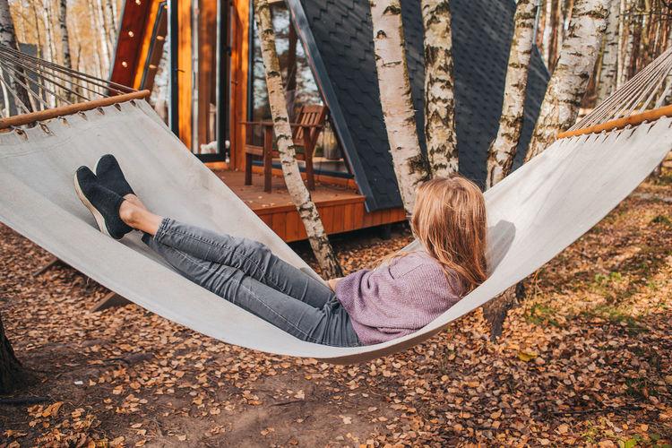 Woman lying down on hammock