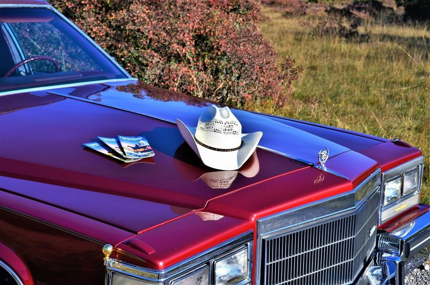 Cheyenne Tourism Cadillac Hat Style  Blue Car Chrome Communication Day Land Vehicle Lighting Equipment Mode Of Transportation Motor Vehicle Nature No People Outdoors Plant Red Retro Styled Sunlight Transportation Travel Tree Vintage Car
