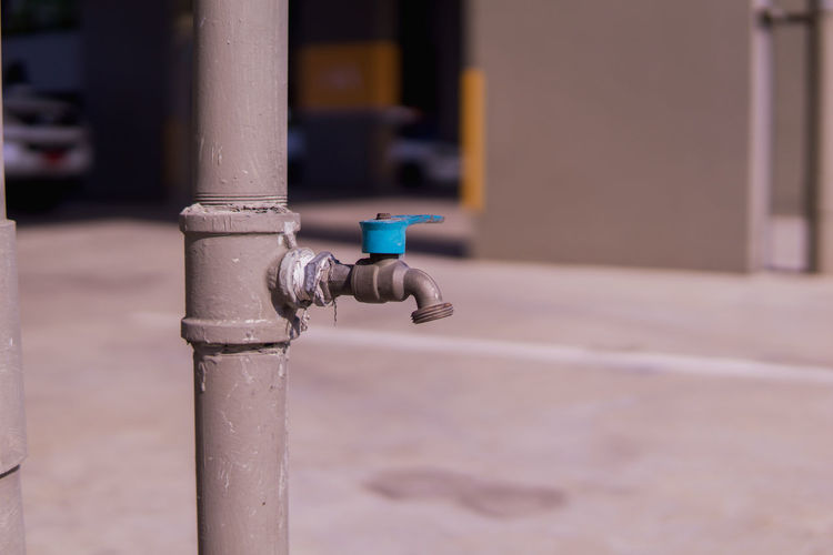 Close-up of faucet on pole against blurred background