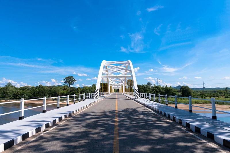 Footbridge against blue sky