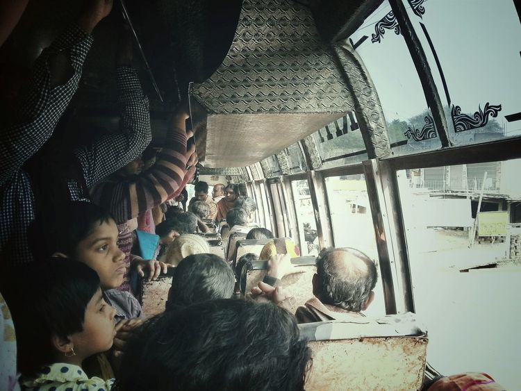Travelling by a crowded bus: in most of the developing/third world countries people travelles in a crowded bus ... its painful.. its uncomfortable... to the child, woman and old aged... but no way.. you have to.../ we too have to avail this facility to travel to office.... people get in, people get down.. bus runs.... passengers travel standing and holding the O ring for an hour...... look at these two child's faces and imagine how its feel.. Check This Out the Snapshots Of Life of people ... not Enjoying Life but its a Suffering EyeEm Gallery Open Edit Eyeem Best Click Eye4photography  EyeEmBestPics Eyeem4photography Youth Of Today EyeEm Best Shots Daily Experience Getting Inspired Inspiring Getty Images Eyeem Best Image NEM Submissions Crowded Bus People Photography Daily Life Song Of The Traveler Everybodystreet Picturing Individuality My Commute