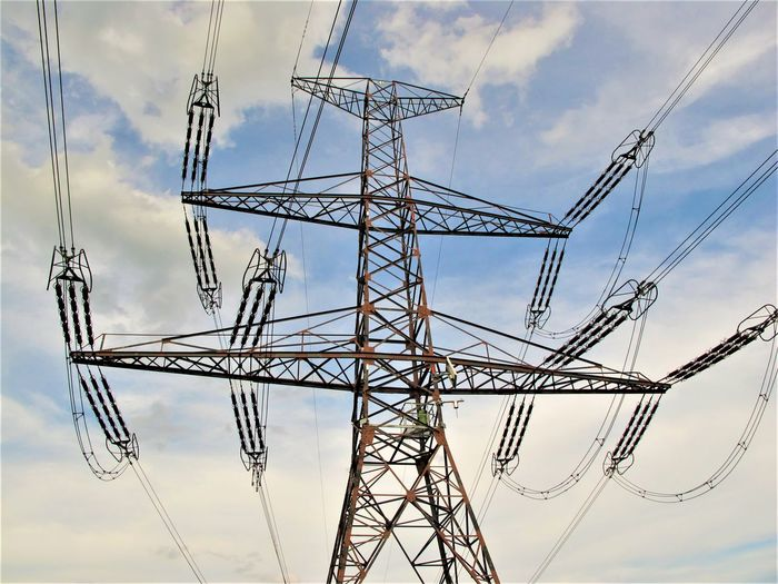 Architecture Built Structure Cable Cloud - Sky Complexity Connection Electrical Equipment Electrical Grid Electricity  Electricity Pylon Fuel And Power Generation Low Angle View Metal No People Outdoors Power Line  Power Supply Sky Tall - High Technology