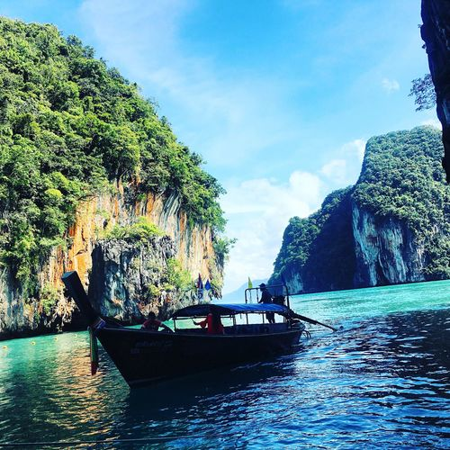 Nautical Vessel Mode Of Transport Transportation Water Tree Nature Beauty In Nature Scenics Sky Day Outdoors Sailing Mountain No People Longtail Boat
