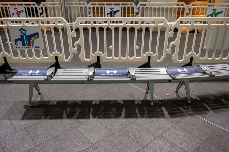 Empty chairs and table on tiled floor