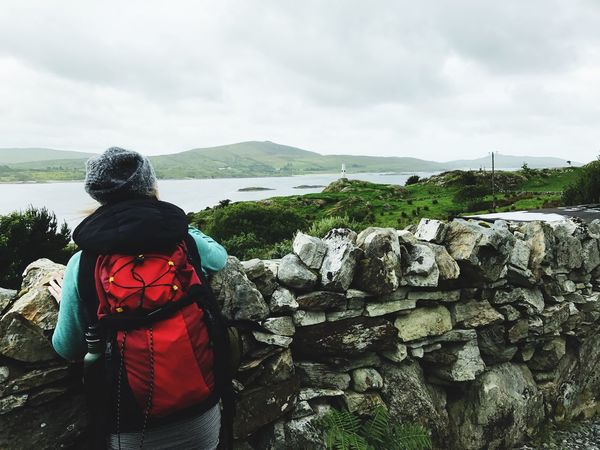 Rear View Hiking Sky Real People Rock - Object Backpack Day Nature Mountain Beauty In Nature One Person Cloud - Sky Lifestyles Tranquil Scene Leisure Activity Outdoors Adventure Looking At View Tranquility Scenics Connemara Ireland Backpacking The Great Outdoors - 2017 EyeEm Awards Wilderness