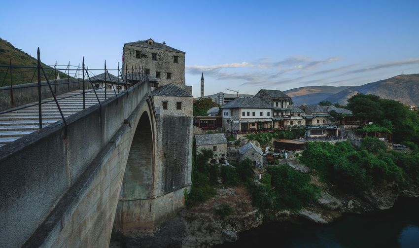 The bridge of old town Mostar Bosnia And Herzegovina Mostar Sunrise Bridge - Man Made Structure Architecture Built Structure Bridge - Man Made Structure Connection Building Exterior Mountain Transportation Outdoors Nature Sky