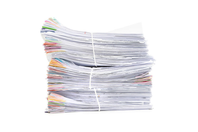 Stack of paper against white background