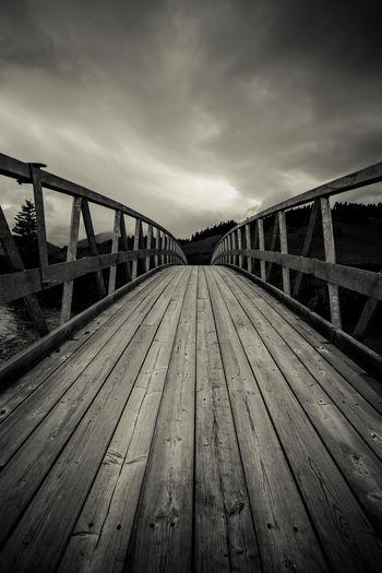 Surface level of footbridge against sky