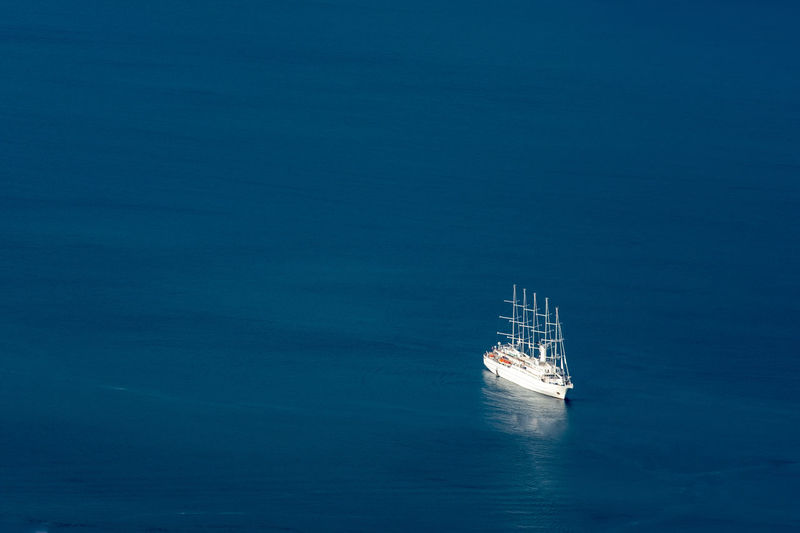 Aerial view of sailboat sailing in sea
