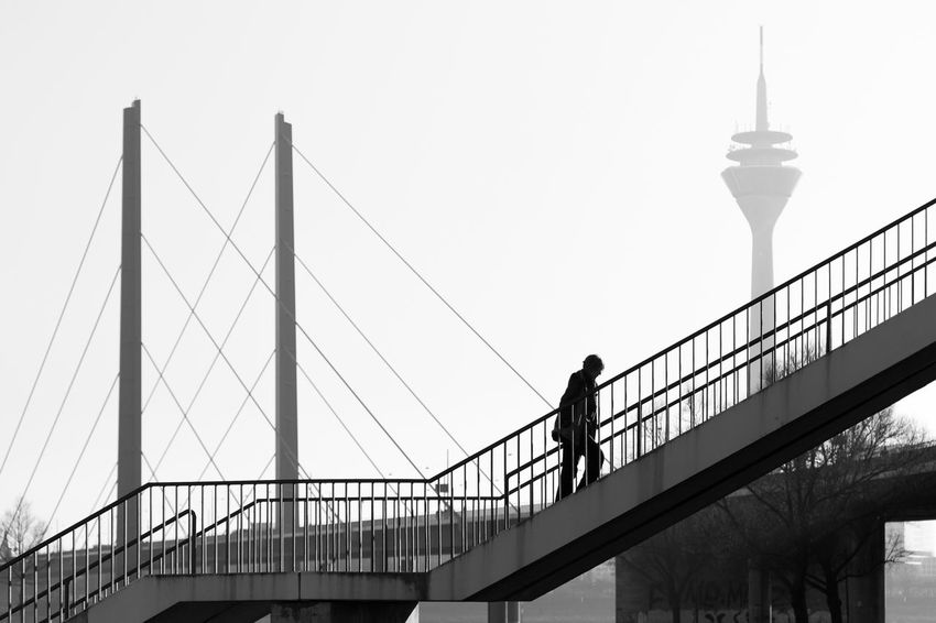 Düsseldorf, Germany Architecture Aufwärts Blackandwhite Bnw Bridge - Man Made Structure Built Structure City Clear Sky Connection Düsseldorf Germany NRW One Person Outdoors Rheinkniebrücke Rheinturm  Schwarzweiß Stairs Suspension Bridge Treppe Upstairs