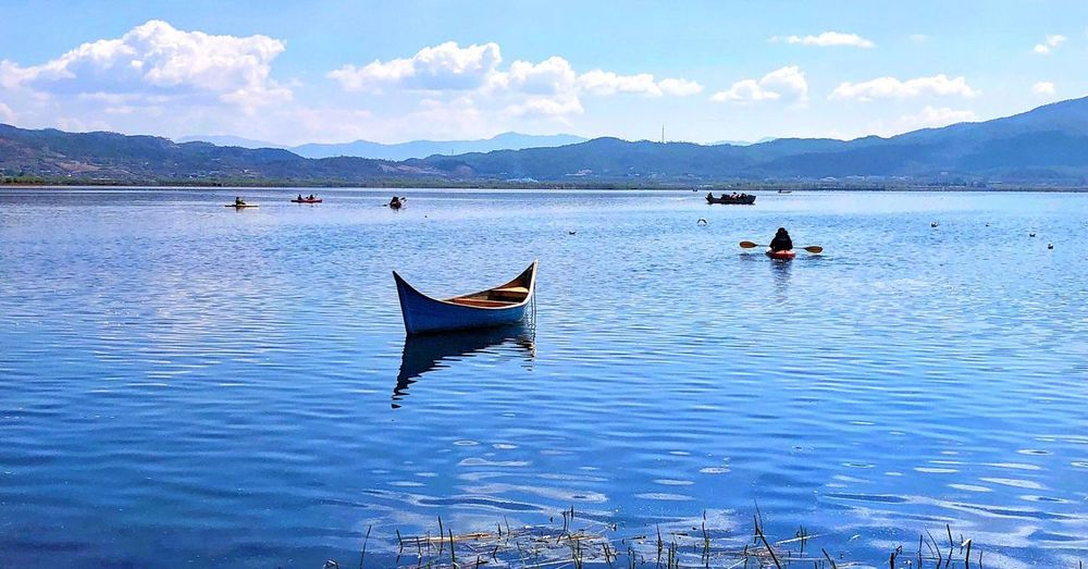 Lashi lake China Lijiang Yunnan Bird Blue Clouds Refection Boat Water Nautical Vessel Mountain Lake Cloud - Sky Tranquility Sky Beauty In Nature Scenics Nature Tranquil Scene Outdoors Day Landscape Occupation Mountain Range