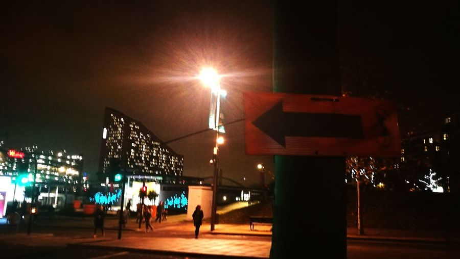 London Street sign Nightlife Night Arrow Illuminated Outdoors People City Sky direction Night Nightlife Adult