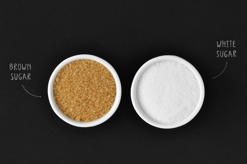 Brown and white sugar in a bowl on black background Diabetic Diet Eating Minerals Sugar Background Black Bowl Brown Cane Sugar Closeup Dieting Food Glucose Health Healthy Ingredient Nutrition Nutritional Organic Refined Sucrose Sweet Tasty White