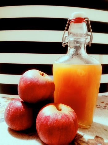 Oggi ho preparato un succo di mele I made some apple juice today Apple Apple - Fruit Apple Juice Apples Black Background Close-up Day Food Food And Drink Freshness Healthy Eating Juice No People Red Variation