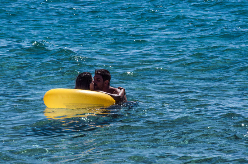 Young Couple Romancing In Sea