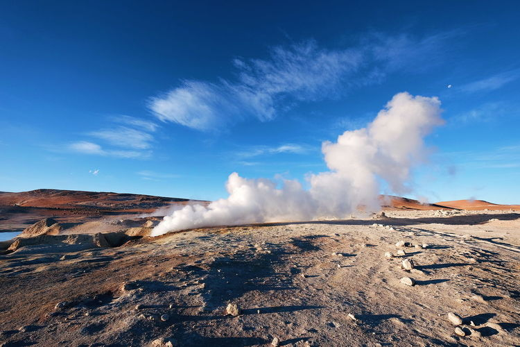 Geysers in Bolivia Landscape Geyser Desert No People Blue Sky Adventure Bolivia Sunny Dry Arid Climate Nature Steam Heat - Temperature Scenics Sky