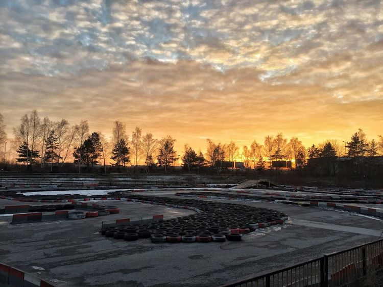 Sunset scenery in Cassovia Ring 😊 Sunset Sky Cloud - Sky Tree Outdoors No People Car Nature Winter Scenics City City Life Beauty In Nature Cassovia Cassovia Ring Go Kart Gokart Gokarting Go Karting Day Beauty In Nature