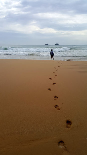 Beach Beach And Sky Brown Sand FootPrint Footprints In The Sand Getting Away From It All Horizon Over Water Sea Solitude