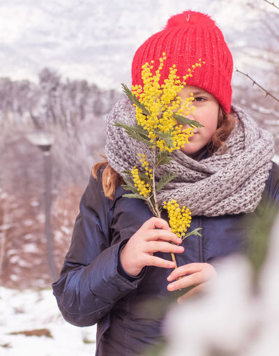Woman holding umbrella during winter