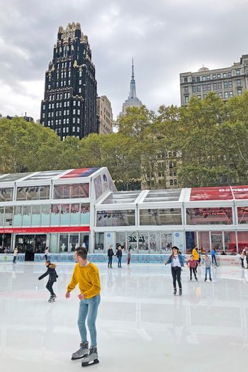 Architecture Ice Rink Real People Built Structure Building Exterior Lifestyles Leisure Activity Day Cloud - Sky Men Sport Winter Sport Sky Ice-skating Large Group Of People City Tree Outdoors Competition Bryant Park  Bryantpark Park Skating Nyc Park NYC Photography