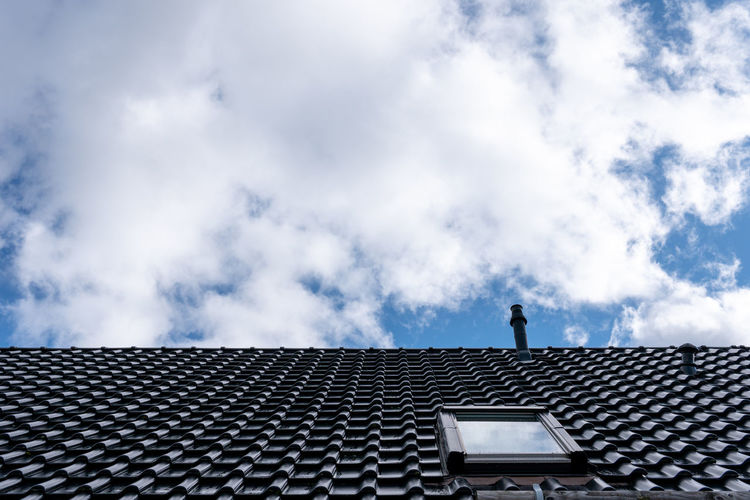 Low angle view of roof of building against sky