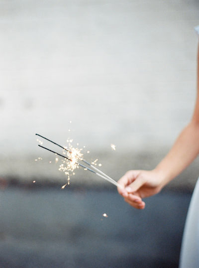 Close-up of hand with sparklers