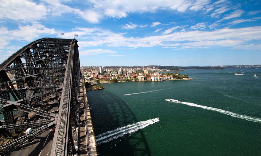 Sydney Harbour Bridge Over Sea Against Sky