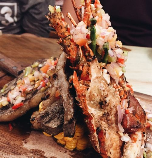 Close-up of lobster served in plate on table