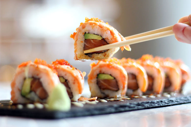 Asian Food Caviar Chopsticks Close-up Finger Food Food And Drink Freshness Hand Healthy Eating Human Body Part Human Hand Indoors  Japanese Food One Person Ready-to-eat Rice Seafood Selective Focus Serving Size Sushi Temptation Tray Wellbeing