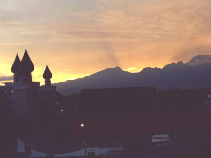 sunset in Indonesia Religion Architecture City Mountain No People Cityscape Sky First Eyeem Photo