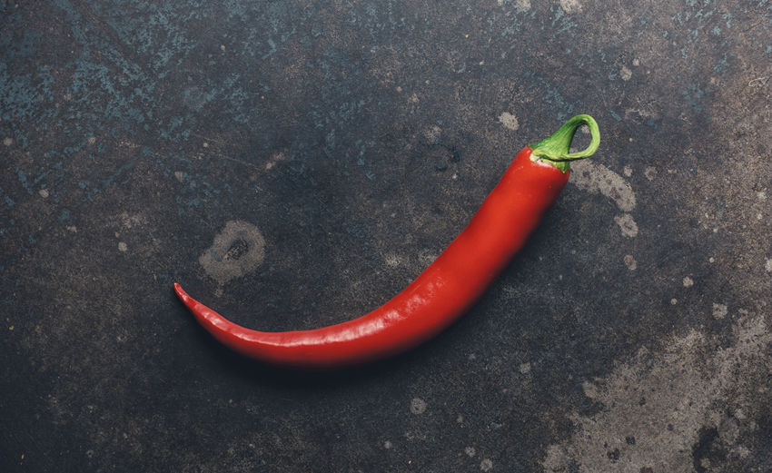 Close-up high angle view of red chili pepper on table