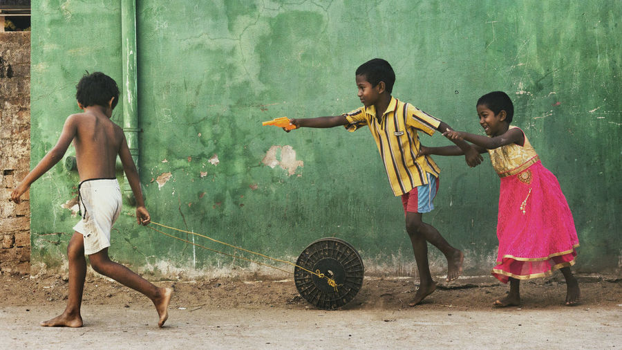 Children playing with umbrella