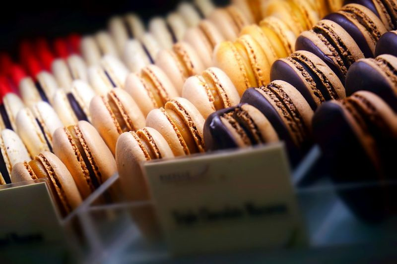 Close-up of colorful macaroons in store