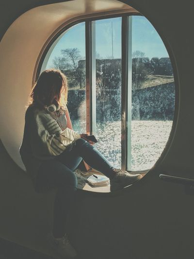 Indoors  Sitting Window Real People Lifestyles Casual Clothing Looking Through Window Women One Person Day Technology Blond Hair Young Adult NewToEyeEm SiljaLine Ferry The Week On EyeEm