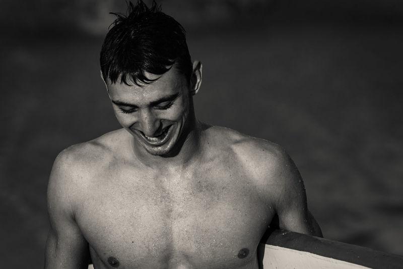 Happy Shirtless Man At Beach